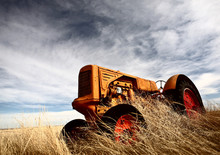 Tumbleweeds Piled Against Abandoned Tractor