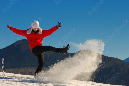Tuinposter Wintersporten Teenager girl playing with snow in a sunny day
