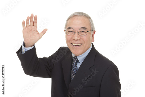 Photo  old Japanese male businessman greetings