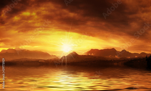 Hot sunset over water surface