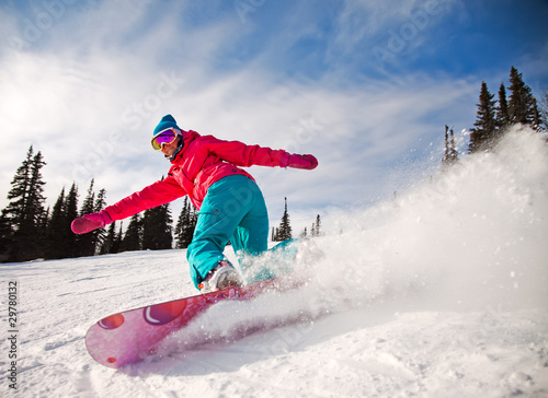 Obrazy Snowboard   snowboarder-jumping-through-air-with-blue-sky-in-background