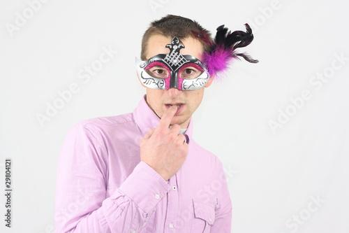 Fotografia, Obraz  Homme masqué avec un doigt dans la bouche