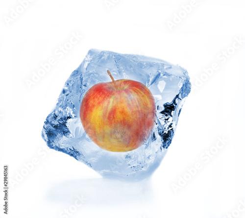 Poster Dans la glace Red apple frozen in ice cube