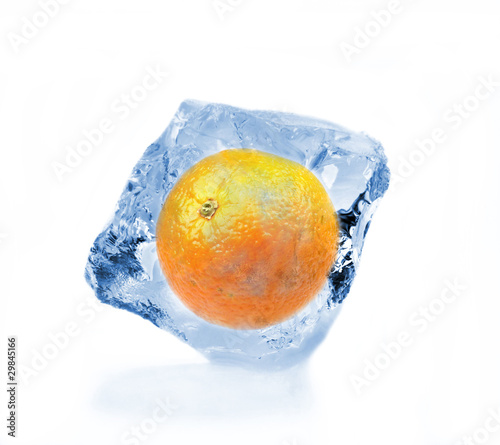 Poster Dans la glace Orange frozen in ice cube, isolated on white background