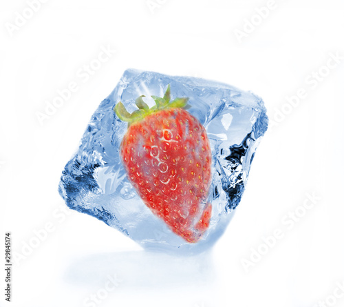 Frozen strawberry in ice cube, isolated on white background