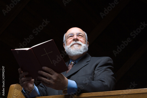 Fotografija  Handsome Senior Caucasian Man Hymnal Church Pew