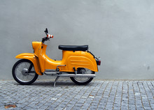 Yellow Motorbike By Grey Concr...