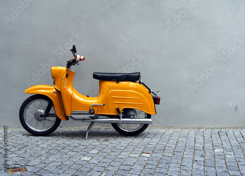 Yellow Motorbike by Grey Concrete Wall