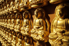 Statues Of Amitabha Buddha On The Wall