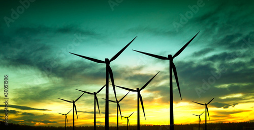 Fotografia  Wind turbines silhouette at sunset