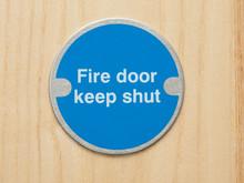 """Fire Safety """"keep Shut"""" Sign On A Wooden Door"""