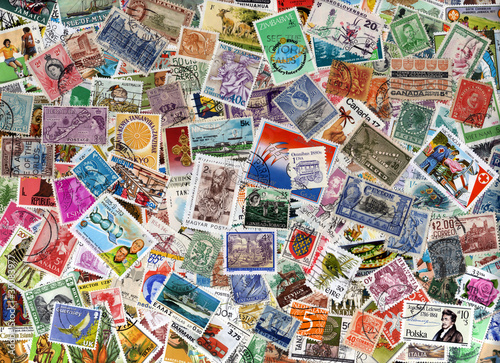 Fotografering  A large world foreign postage stamp collection background