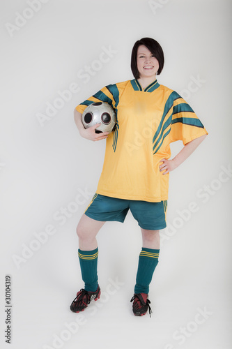Fussballerin In Gelben Trikot Buy This Stock Photo And