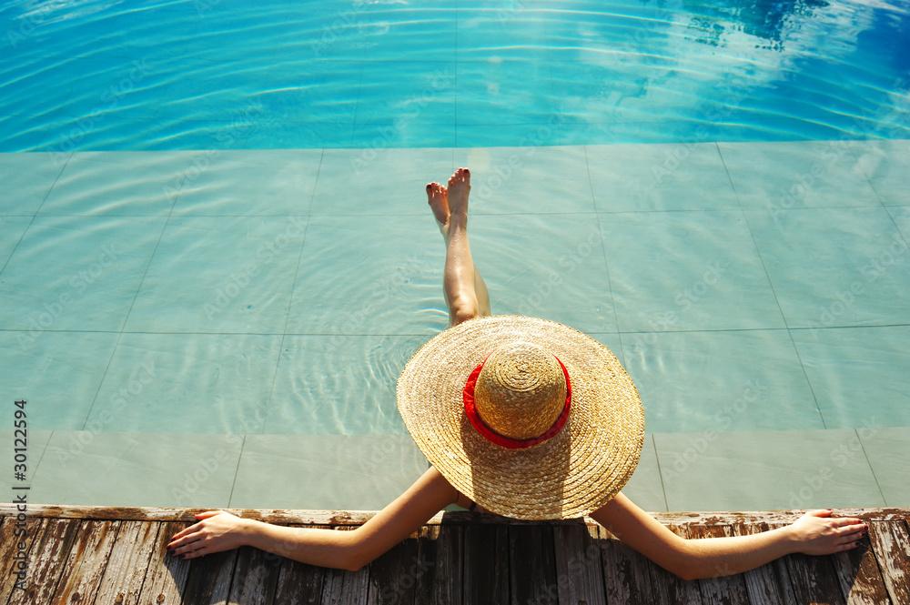 Fototapeta Woman at poolside