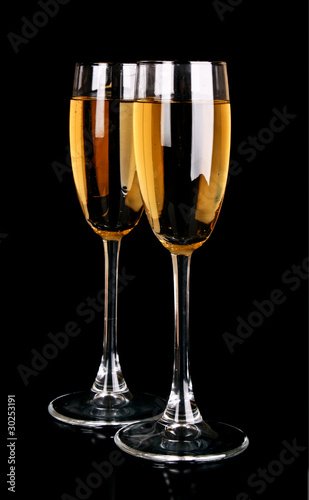Glasses with champagne on black background