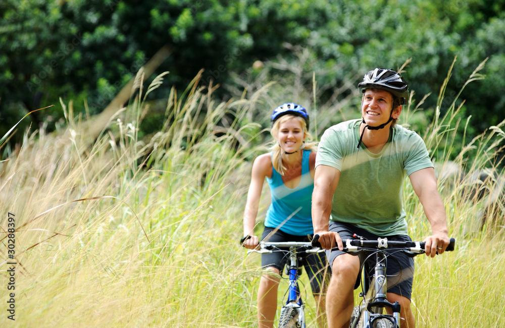 Fototapeta mountainbike couple outdoors