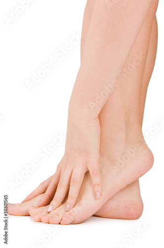 Poster Pedicure Female feet isolated on white background