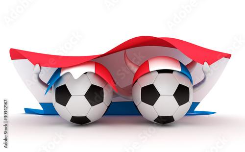 Two soccer balls hold Netherlands flag