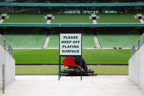 Foto op Plexiglas Stadion Rows of folded, green, plastic seats in very big, empty stadium,