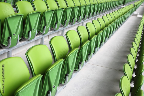 Spoed Foto op Canvas Stadion Rows of folded, green, plastic seats in very big, empty stadium