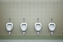Row Of Four Urinals. 3D Rendered Image.