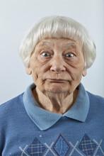 Goofy Senior Woman Head And Shoulders Portrait