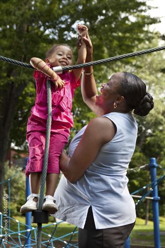 Foto op Aluminium Afrika Mother and daughter playing at a park