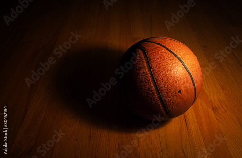 Basketball with spot light Poster