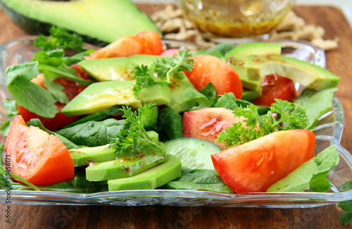 Poster de jardin Vache salad with tomato and avocado on a crystal plate