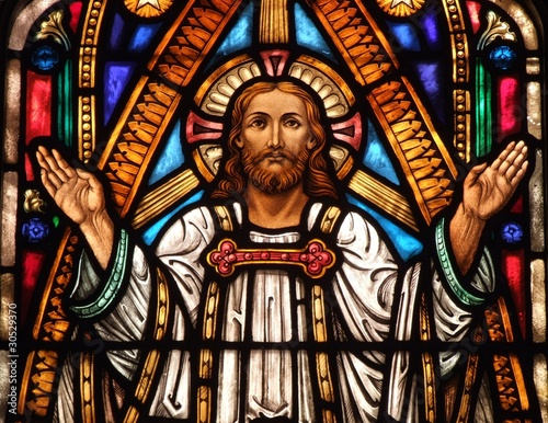 Fotografie, Obraz  Stained Glass window of Jesus with his hands up