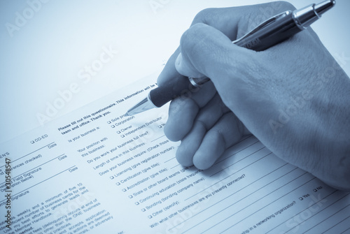Valokuva  Filling Out a Business Questionnaire