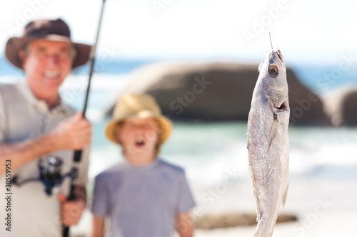 Fotobehang Vissen Man fishing with his grandson