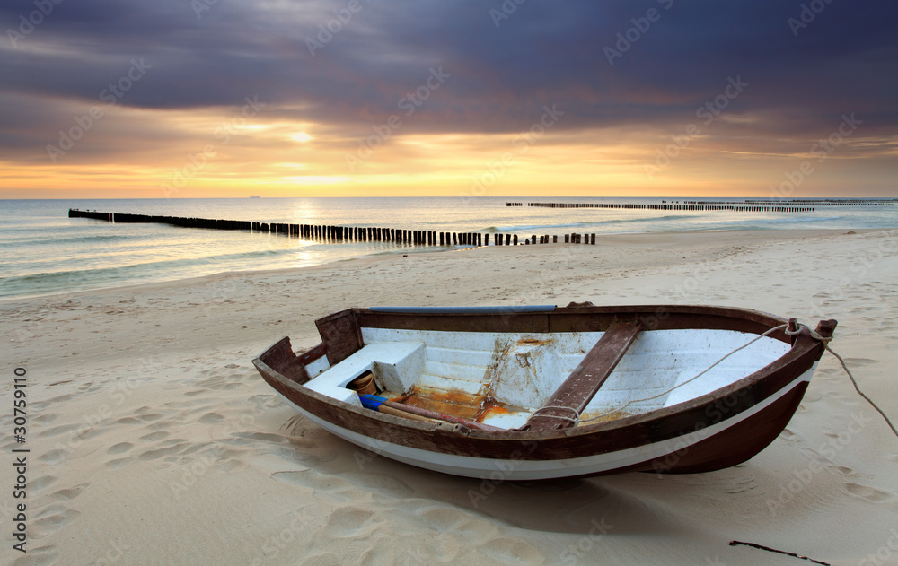Fototapeta Boat on beautiful beach in sunrise