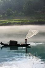 Fisherman Casting Net On River