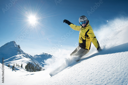 Garden Poster Winter sports Young snowboarder in deep powder - extreme freeride