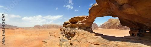 Leinwand Poster natural bridge and panoramic view of Wadi Rum desert, Jordan