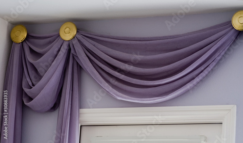 Valance drapery treatment with high ceiling above doorway Wallpaper Mural