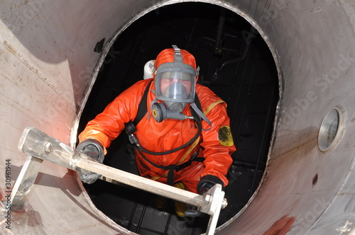 Fotografia  man in chemical suit