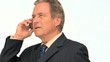 Aged businessman in suit taking a phone call
