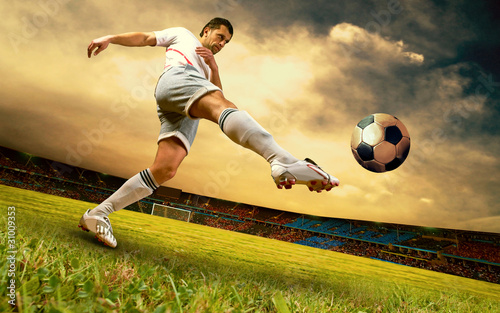Poster voetbal Happiness football player on field of olimpic stadium on sunrise