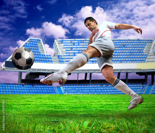 Tuinposter Voetbal Happiness football player after goal on the field of stadium und