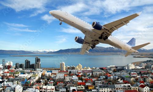 Fényképezés  Airplane above Reykjavik town. Island