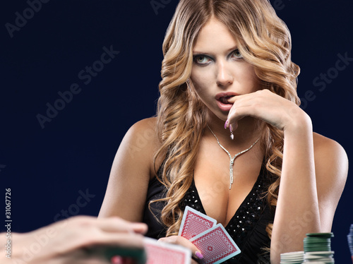 Photo  Woman doubt in a card gambling match