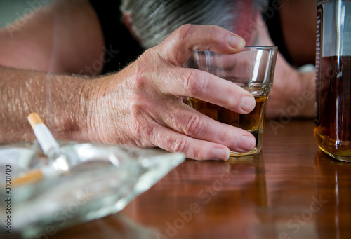 Fotografie, Obraz  alcoholism - desperate man with whiskey and cigarettes