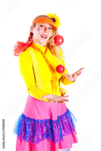 A girl dressed as Pippi Longstocking juggling Fototapet