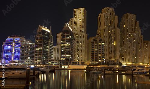 Obrazy na płótnie Canvas Town scape at night time. Panoramic scene, Dubai.