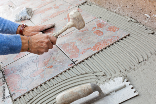 Posa in opera pavimenti - Buy this stock photo and explore similar ...