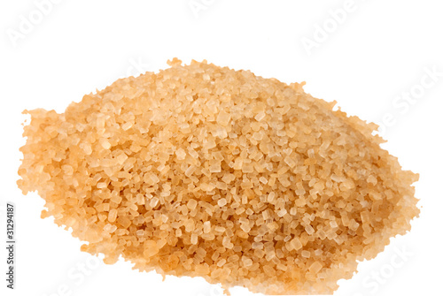 Valokuva  raw sugar isolated on a white background