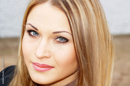 young blonde with blue eye
