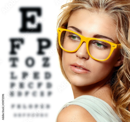 eye test chart and woman in glasses Canvas Print